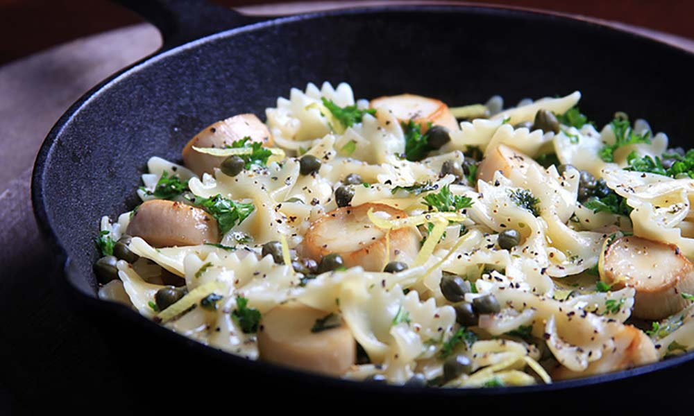 Mushroom 'scallops' with creamy white wine sauce and pasta